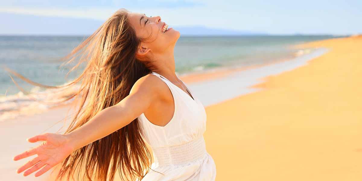 happy woman on a beach