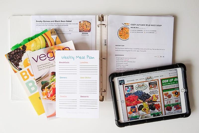 Cookbooks, meal planning printable, sale ad, and recipe binder.