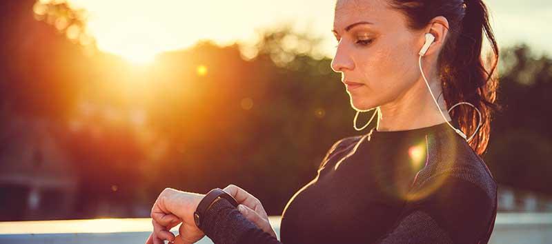 woman using fitness tracker