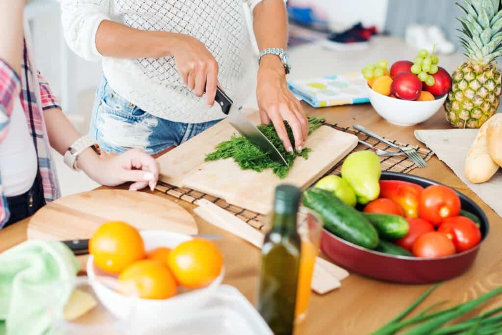 women preparing healthy food