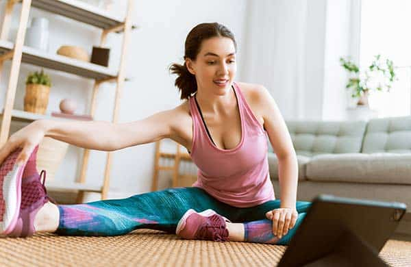 woman stretching at home