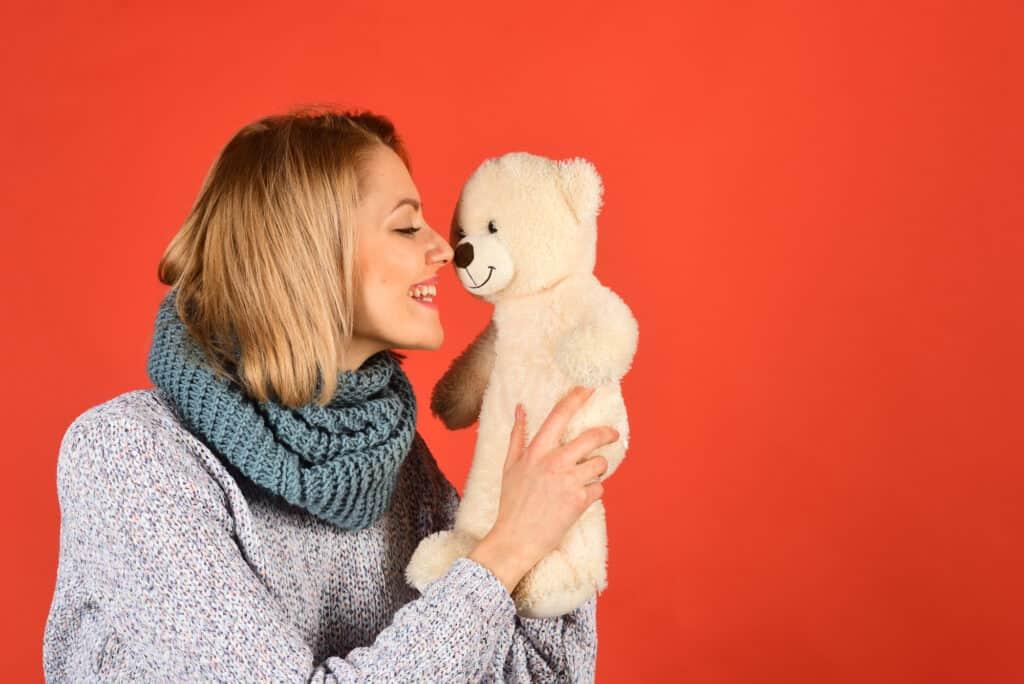 Woman with lovable teddy bear