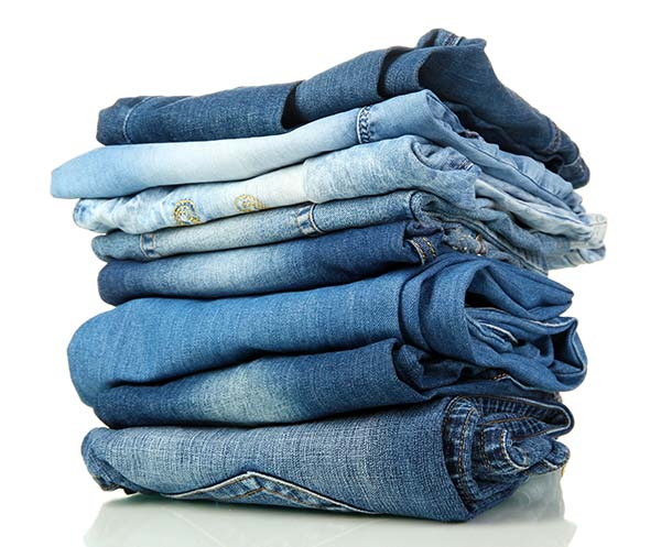 pile of 8 jeans
