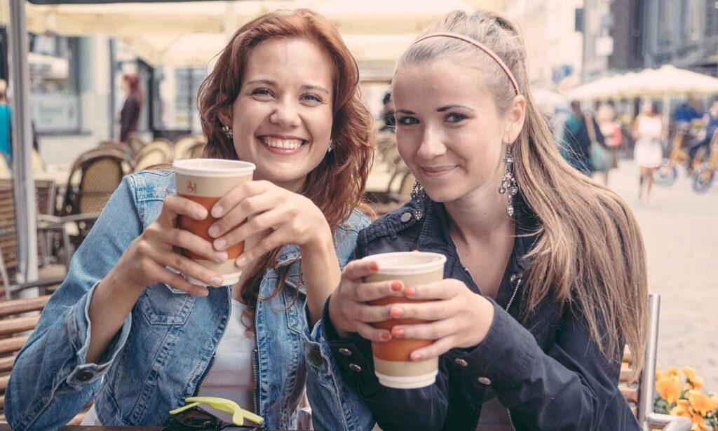 two female friends having coffee