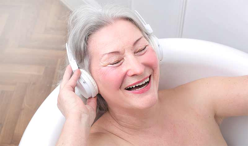woman in bath listening to music