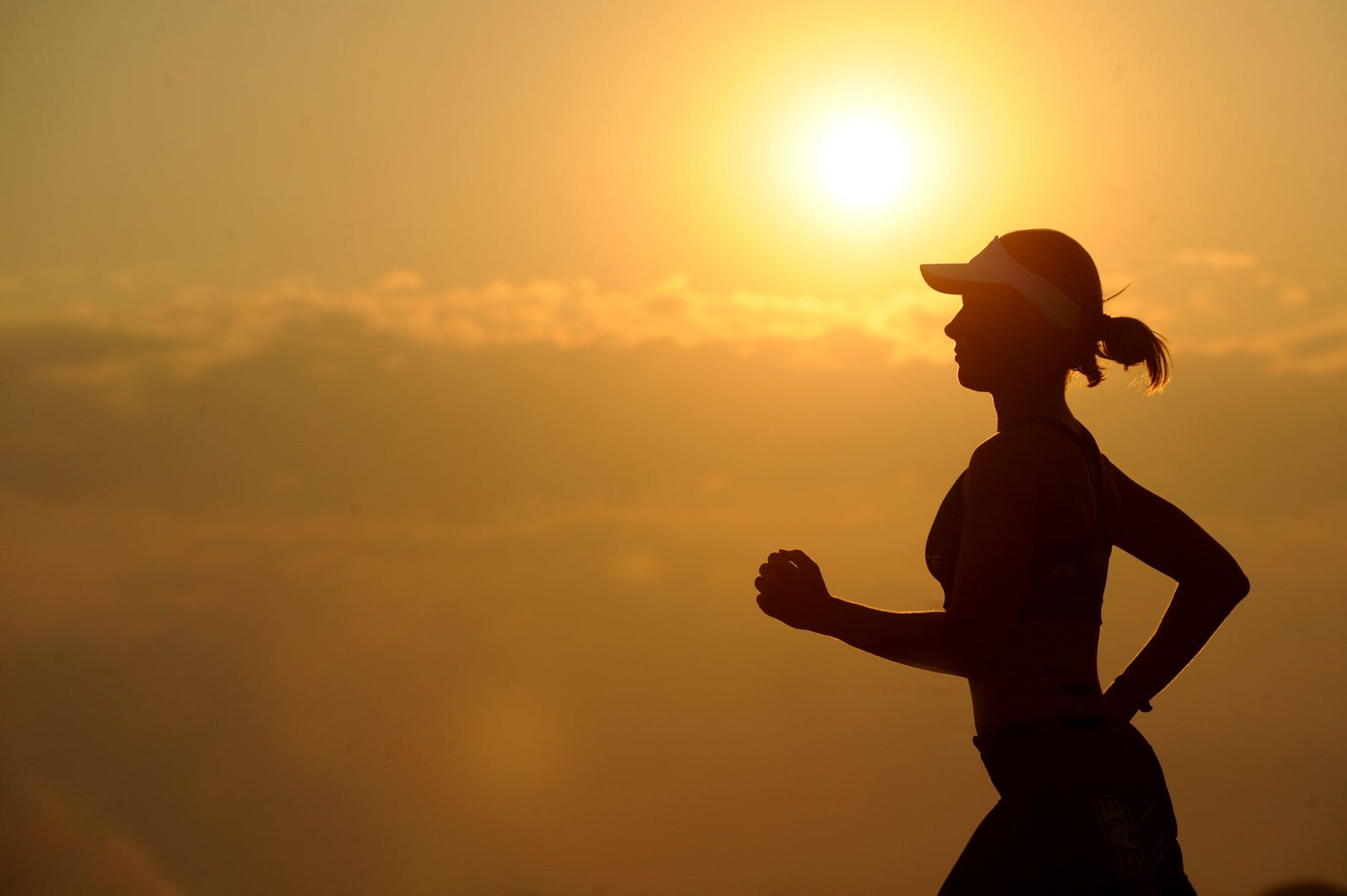 woman running with sunset