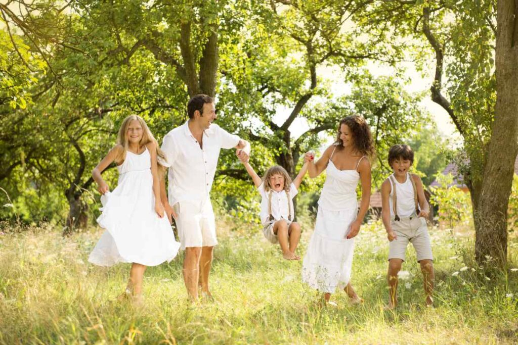family in all-white outfits in the forest