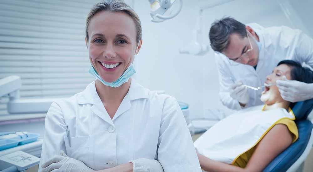 dental hygienist with dentist