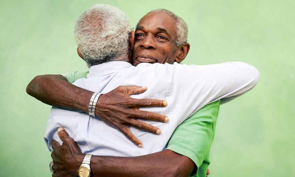 two african-american men hugging