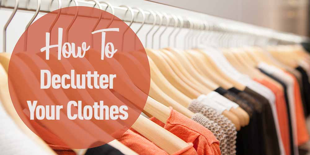 closet with hangers and clothes