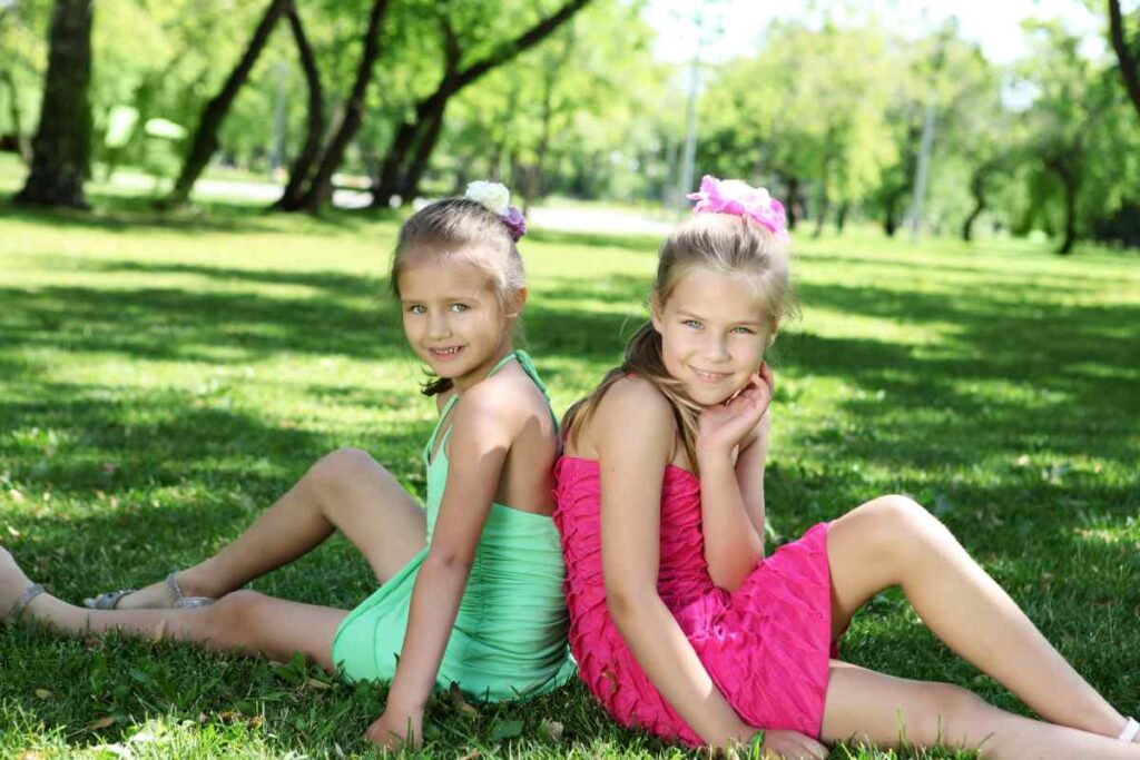 2 girls with bright dresses at the park
