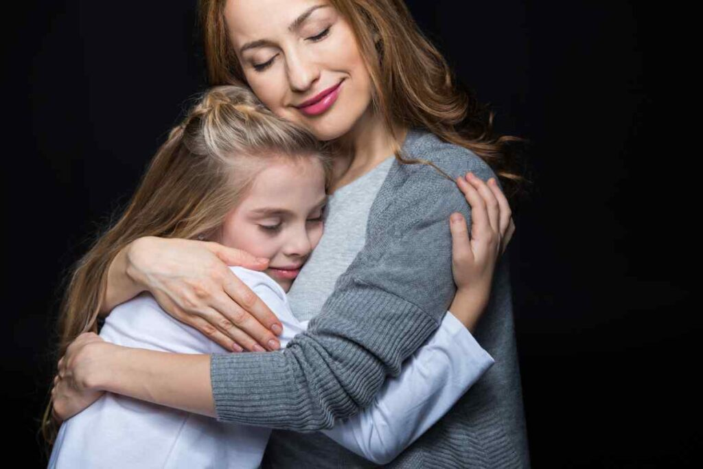 mother and girl hugging