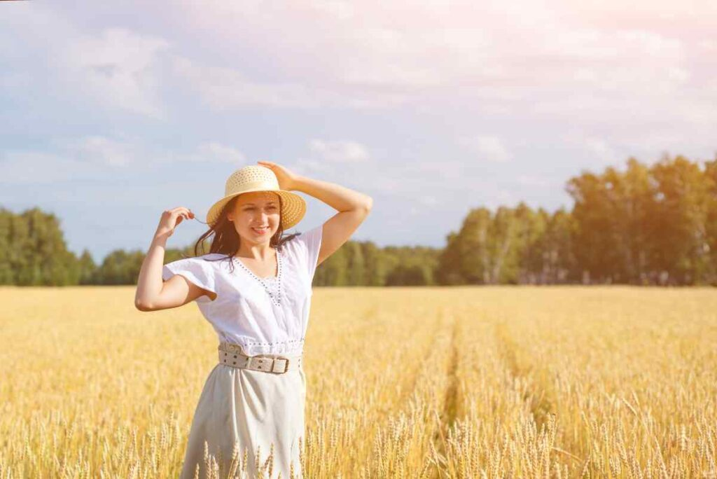 mom in a field with a great outfit